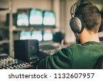 behind the scene. film crew in... | Shutterstock . vector #1132607957