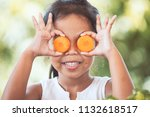 cute asian child girl having... | Shutterstock . vector #1132618517