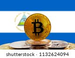 bitcoin btc on stack of... | Shutterstock . vector #1132624094