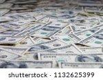 paper 100 dollar bills spread... | Shutterstock . vector #1132625399