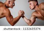 two men arm wrestling. rivalry  ... | Shutterstock . vector #1132635374