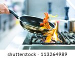 Chef In Restaurant Kitchen At...