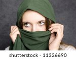 green scarf cover face of girl - stock photo