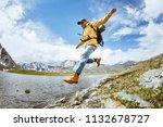 Man Hiker Jumps From Big Rock...