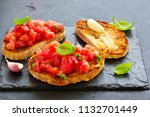 bruschetta with tomatoes and... | Shutterstock . vector #1132701449