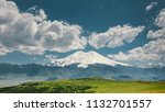 elbrus mount and green hills at ... | Shutterstock . vector #1132701557