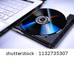 Dvd Disk On The White Laptop...