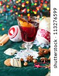 Glass of mulled wine and cookies - stock photo