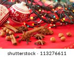 Closeup of spices and Christmas decorations in the background - stock photo