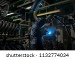 industrial workers are welding... | Shutterstock . vector #1132774034