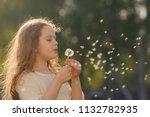 curly girl blowing dandelion in ...   Shutterstock . vector #1132782935