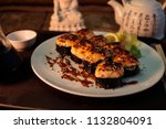 composition of baked sushi... | Shutterstock . vector #1132804091