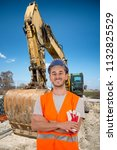 worker with bulldozer in road... | Shutterstock . vector #1132825529