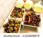 antipasti olives and butter | Shutterstock . vector #1132848875