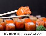 mens hand holding wooden sticks ... | Shutterstock . vector #1132915079