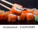mens hand holding wooden sticks ... | Shutterstock . vector #1132915085
