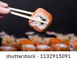 mens hand holding wooden sticks ... | Shutterstock . vector #1132915091
