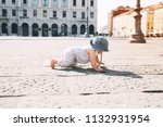 baby girl crawling on a... | Shutterstock . vector #1132931954