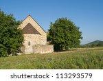 medieval catholic chapel at summer - stock photo