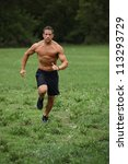 Strong and fit man running - stock photo