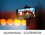 smartphone on selfie monopod... | Shutterstock . vector #1132948334