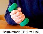 business man holding dumb bell...   Shutterstock . vector #1132951451