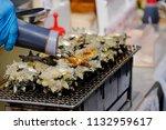 closeup shot of hand putting... | Shutterstock . vector #1132959617