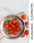 tiny cherry tomatoes in a...   Shutterstock . vector #1132983794