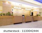 Stock photo hotel reception area desk 1133042444