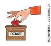 hand inserting heart to box...   Shutterstock .eps vector #1133055707