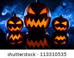 three halloween pumpkins in the ... | Shutterstock . vector #113310535