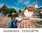 young woman traveler with... | Shutterstock . vector #1133118794