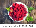 berries of ripe raspberries lie ... | Shutterstock . vector #1133121881