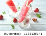 glass with delicious strawberry ...   Shutterstock . vector #1133135141