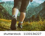woman hiking in mountains | Shutterstock . vector #1133136227