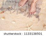 young woman standing on beach... | Shutterstock . vector #1133138501