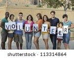 happy and diverse volunteer... | Shutterstock . vector #113314864