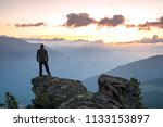 young man standing on the edge... | Shutterstock . vector #1133153897