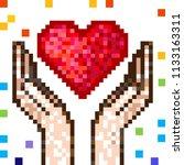 pixel red heart in hands.... | Shutterstock .eps vector #1133163311