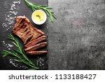 slate plate with tasty steak ...   Shutterstock . vector #1133188427
