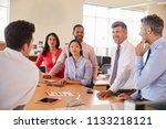 business team meeting in an... | Shutterstock . vector #1133218121