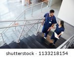 two healthcare colleagues... | Shutterstock . vector #1133218154