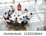 businesswoman addressing team... | Shutterstock . vector #1133218664