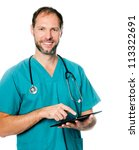 Smiling doctor using a tablet computer isolated on a white background - stock photo