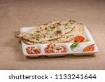 paneer kulcha with stuffing the ... | Shutterstock . vector #1133241644