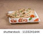 paneer kulcha with stuffing the ... | Shutterstock . vector #1133241644