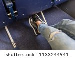 female passenger stretching her ... | Shutterstock . vector #1133244941