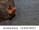 Small photo of rusty anchorage ground