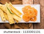 crispy fafda with sweet jalebi... | Shutterstock . vector #1133301131