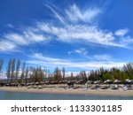 sand beach with deck chairs ... | Shutterstock . vector #1133301185